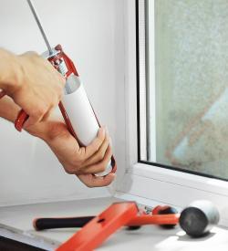 air sealing a window using a caulking gun